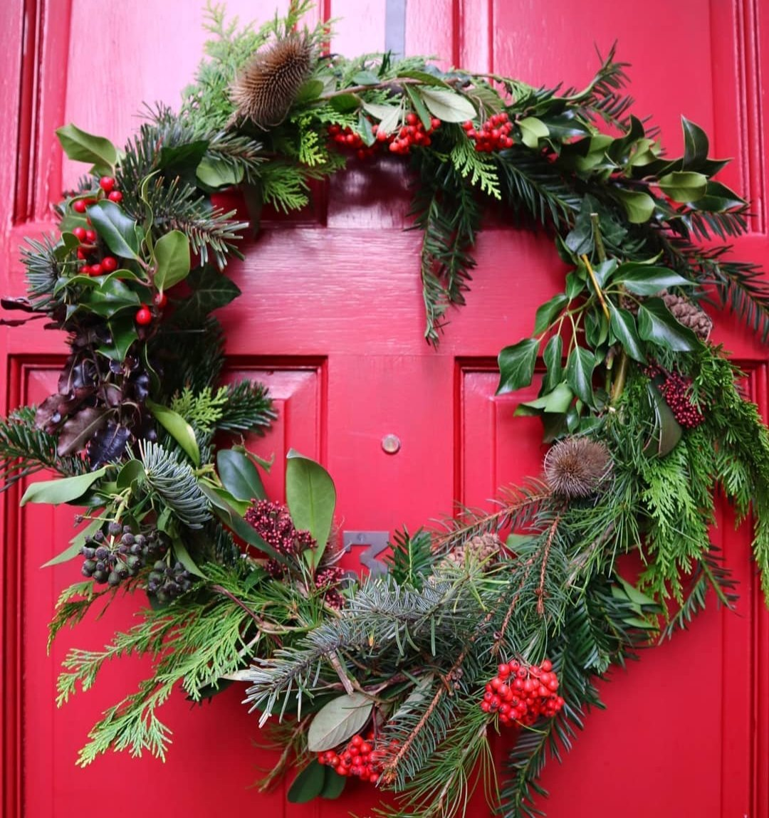 Natural Christmas wreath on red front door